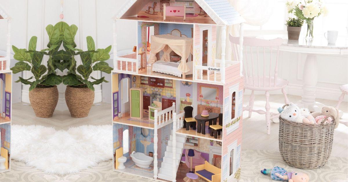 kidkraft dollhouse set up in child's bedroom
