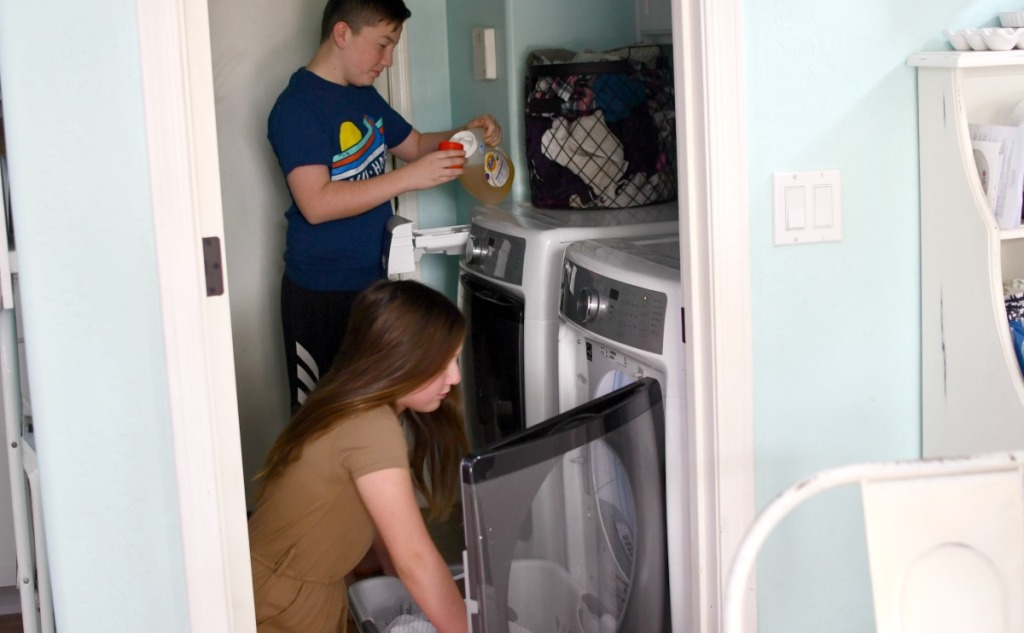 kids doing the laundry