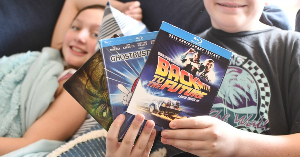 kids holding dvd movies