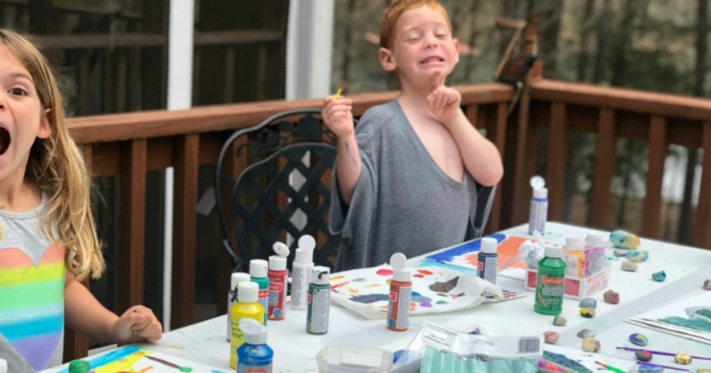 kids painting on outside deck