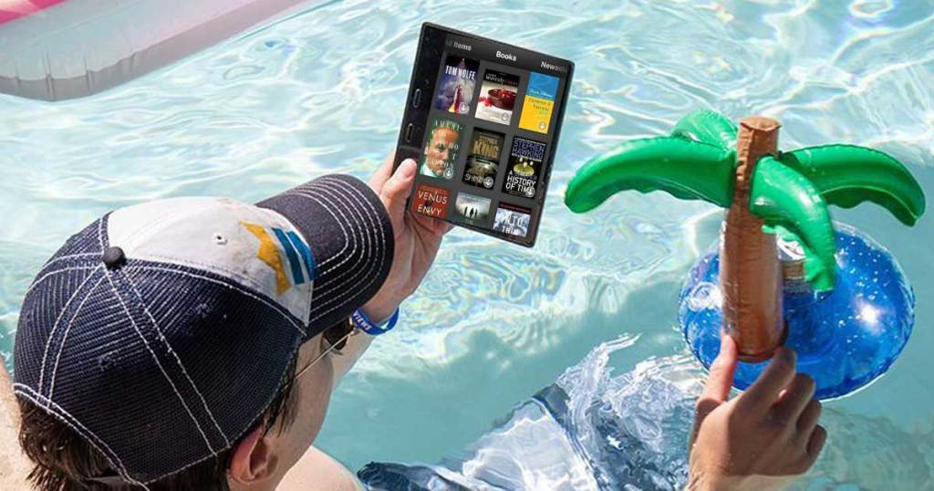 man in pool reading kindle books
