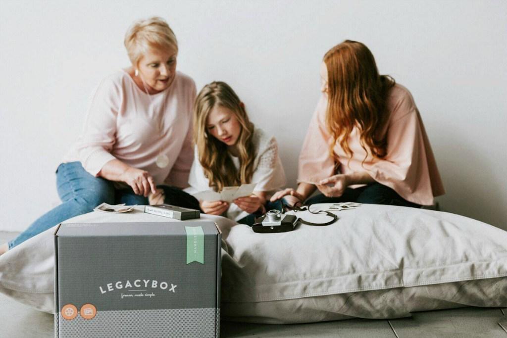 three women looking at photos