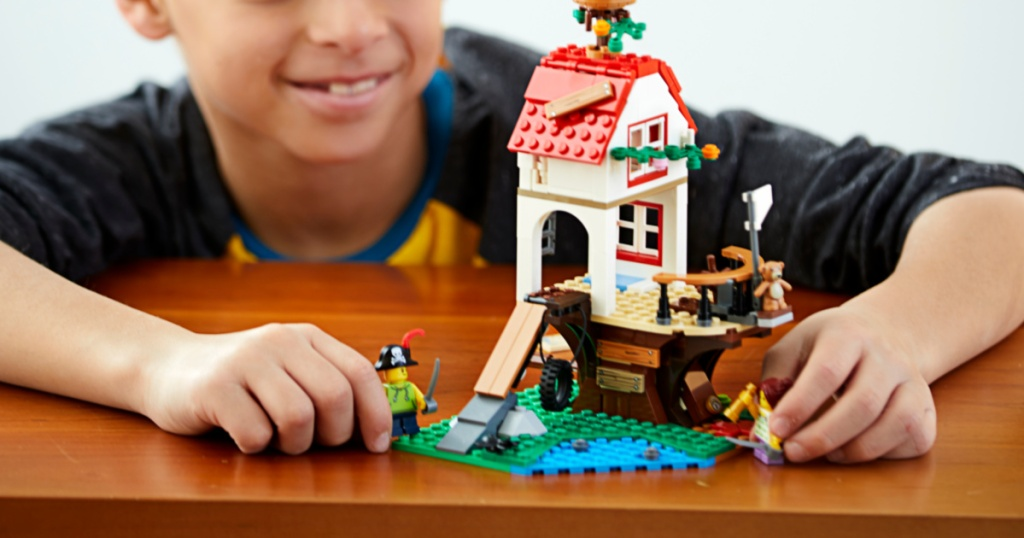 lego treehouse with little boy playing