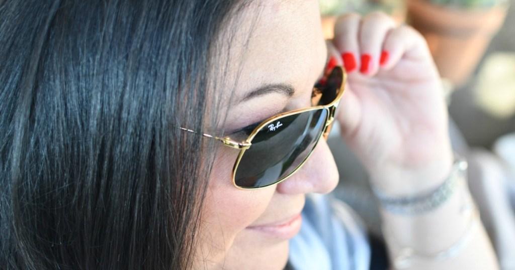 woman wearing stylish pair of sunglasses