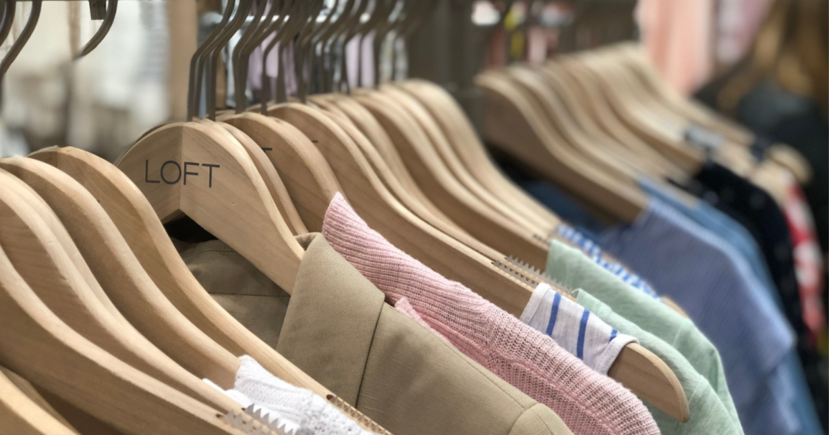 loft outfits on hangers in store