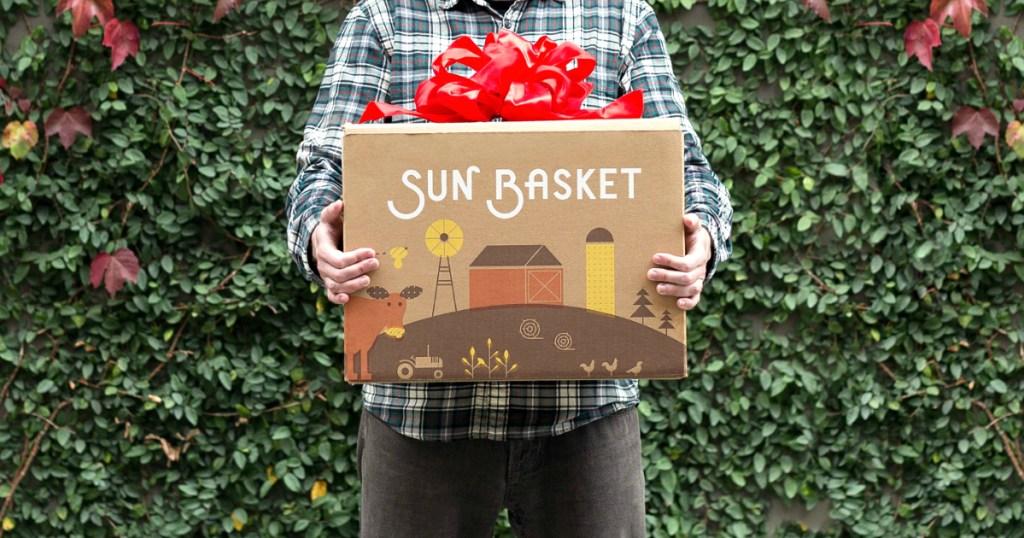 man holding Sun Basket box
