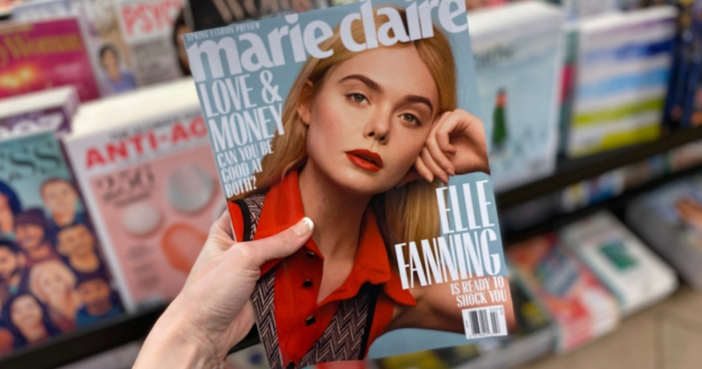 hand holding Marie Claire magazine