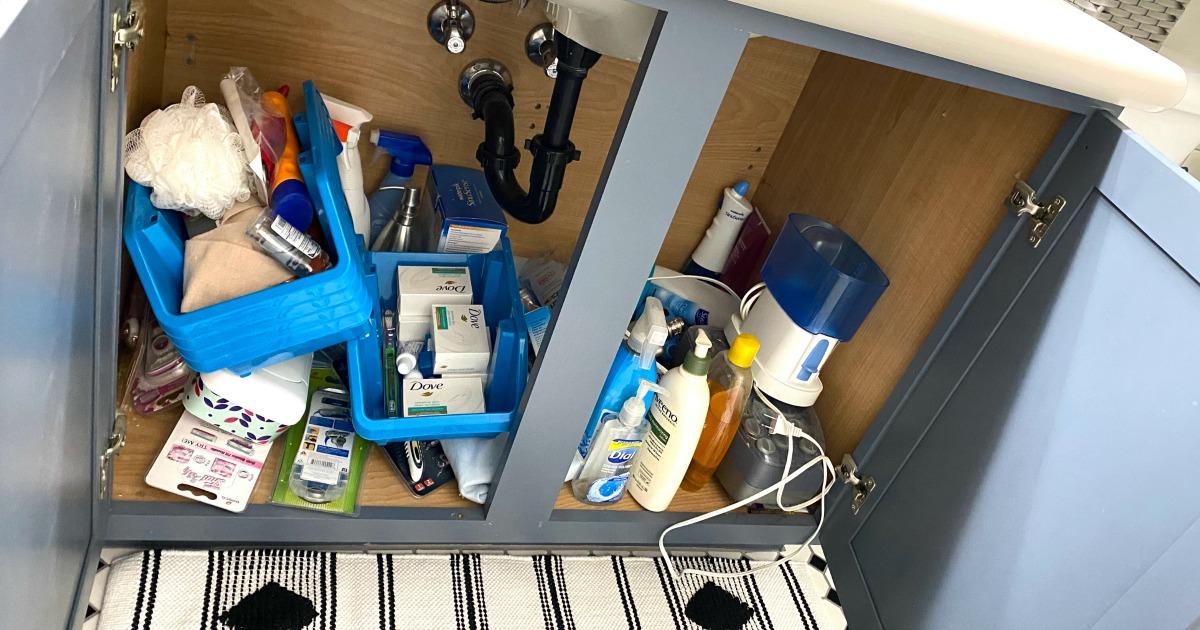 messy bathroom cabinet before organizing