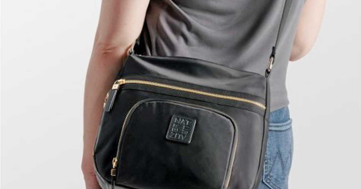 woman wearing a naturalizer purse
