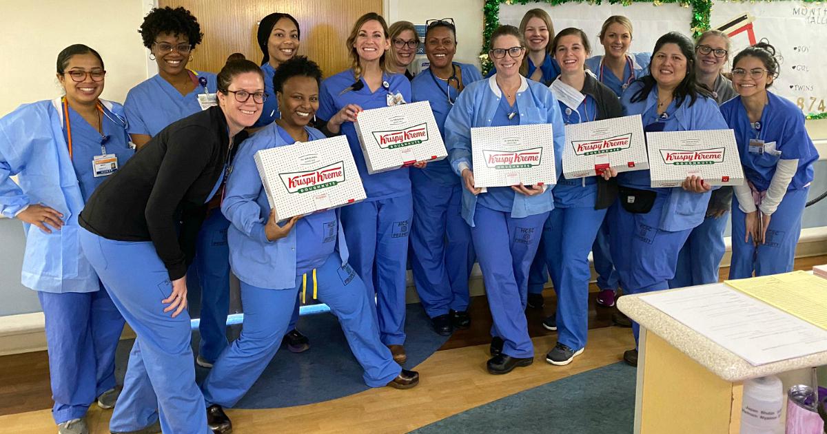 nurses holding krispy kreme boxes