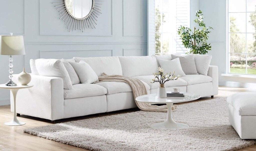 white couch sitting in living room with big windows