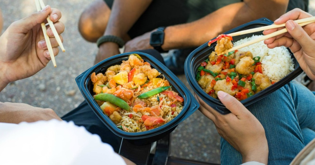 people holding multiple pei wei entrees
