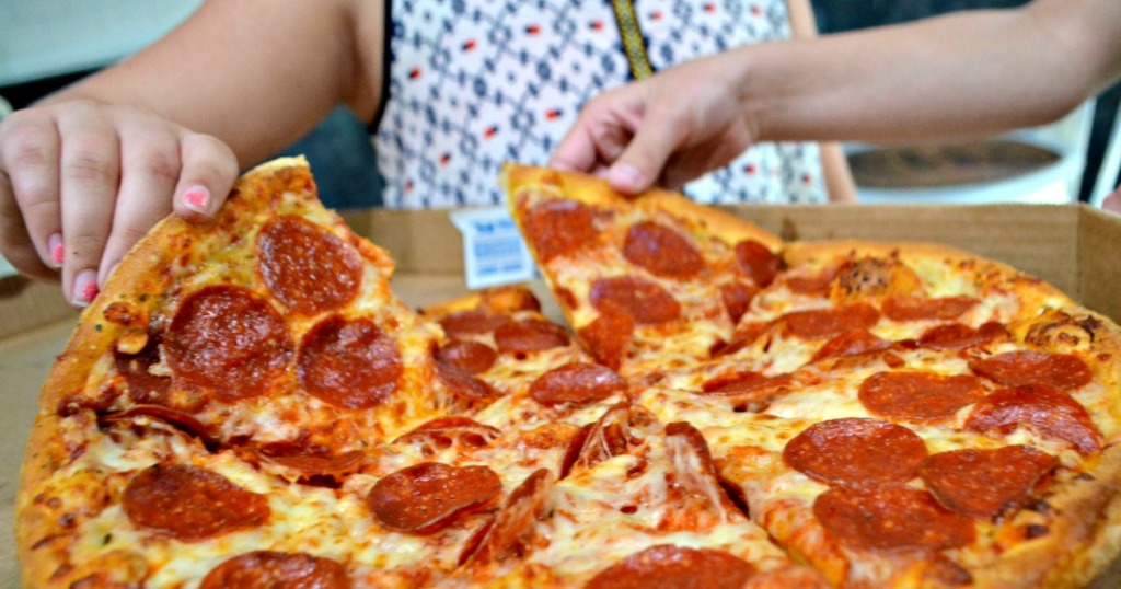 picking up pepperoni pizza slices