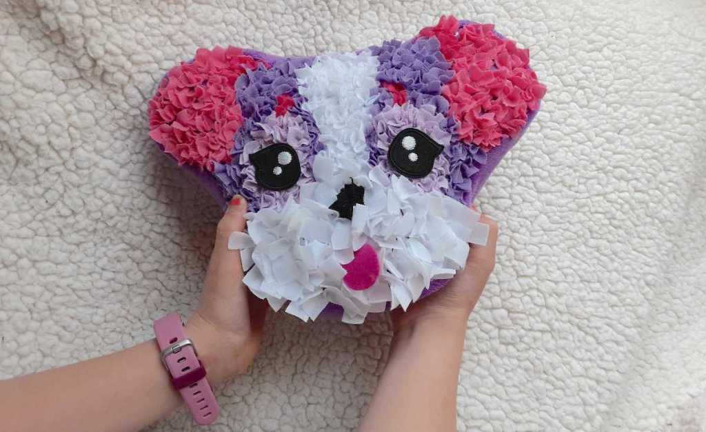 kids hands holding colorful white pink purple dog head