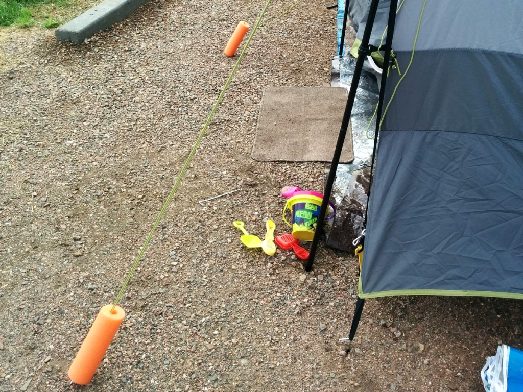 camping hacks - pool noodles on tent lines