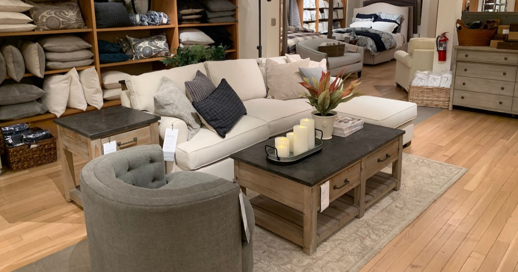 store living room set up with couch pillows coffee table and chair