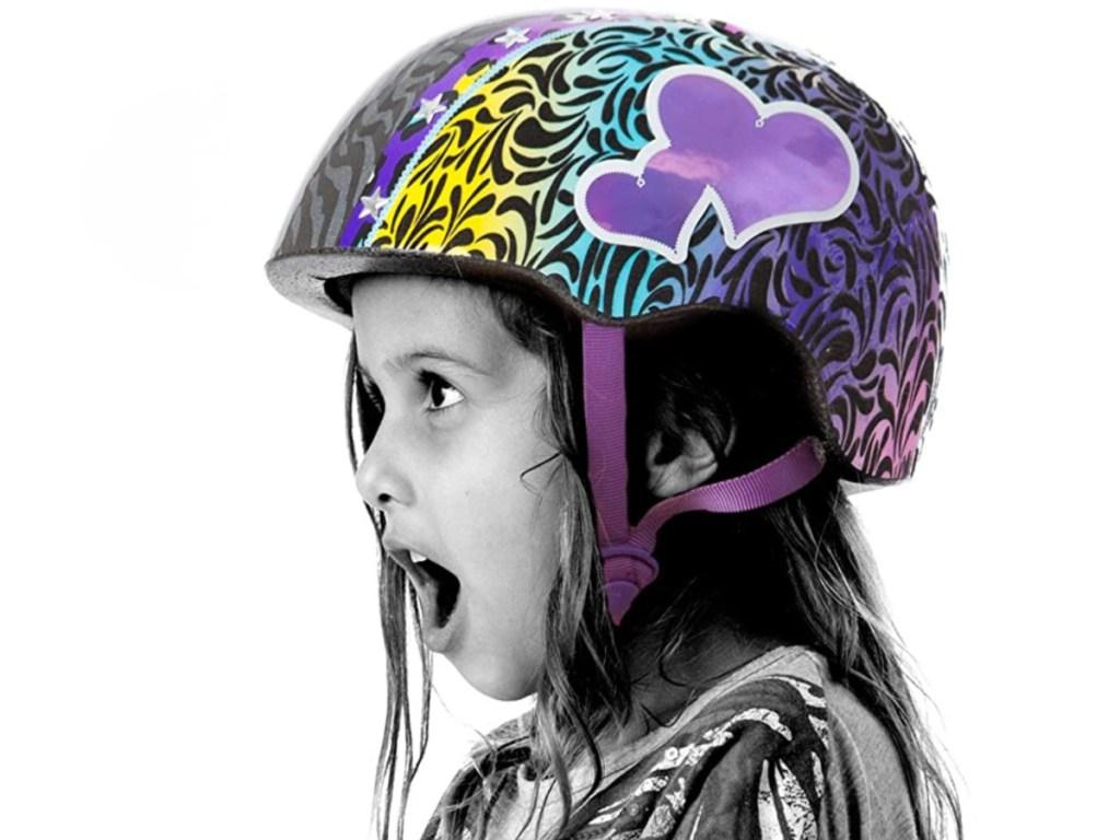 girl wearing heart helmet