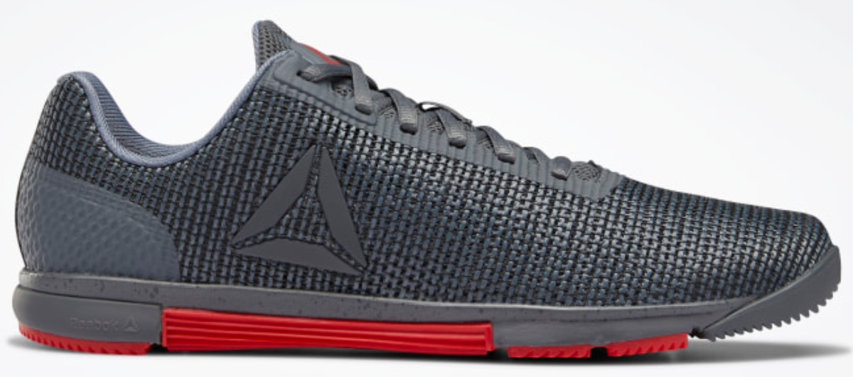 stock image of grey and red reebok mens trainers