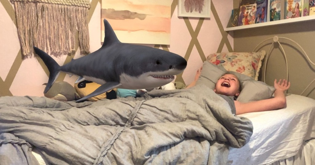 shark over girl in bed