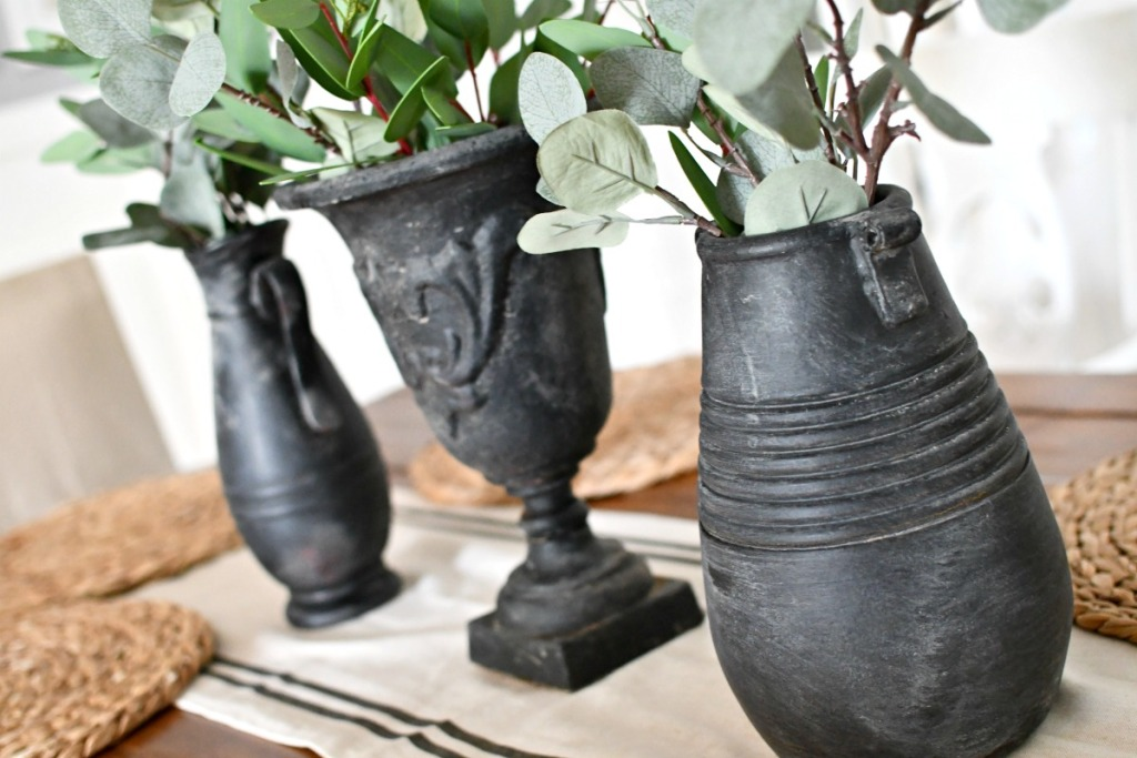 spray paint and dirt covered vases