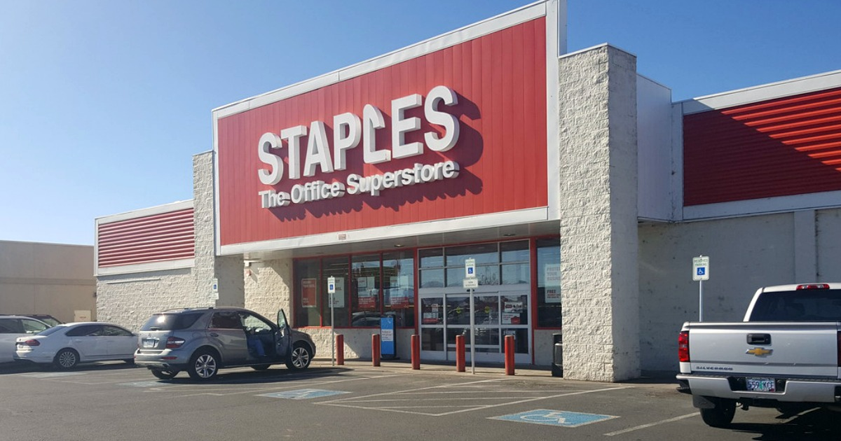 staples store front with cars outside