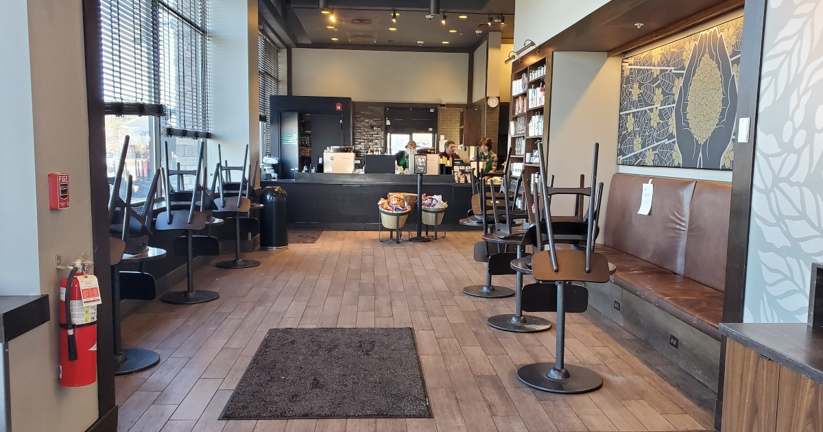 empty Starbucks with chairs stacked