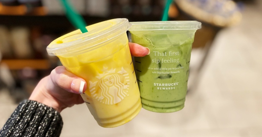 hand holding yellow and green cold drinks