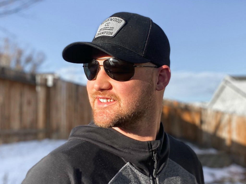 man wearing sunglasses outside by snow