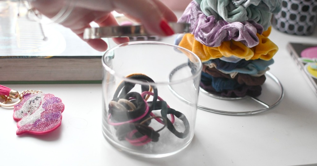 storing hair bands in a bath and bodyworks candle jar