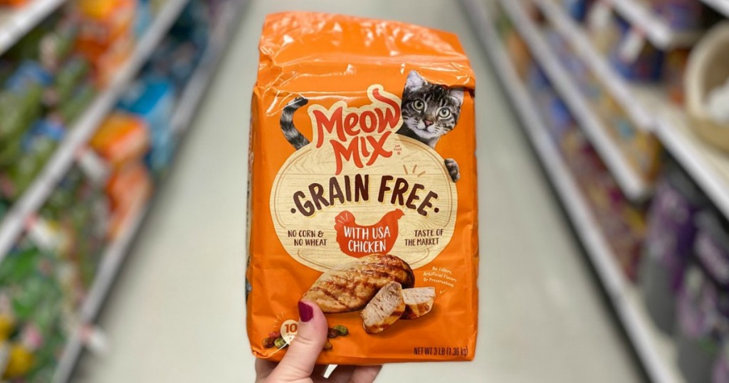 hand holding a bag of cat food in a store