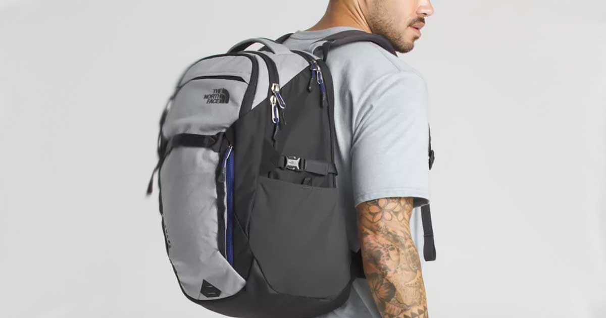man wearing The North Face Surge 31-Liter Backpack