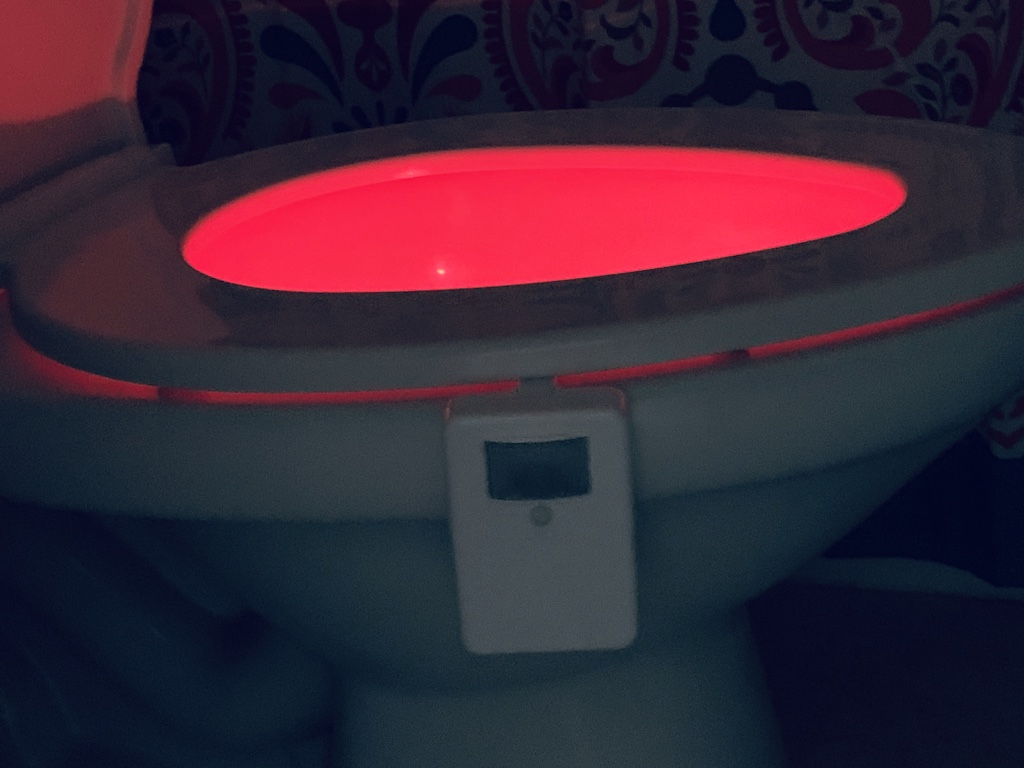 toilet seat with bright color light