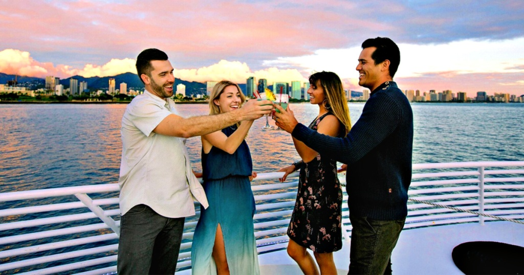 two couples toasting champagne on a boat
