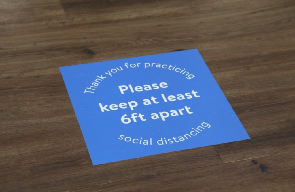 floor decal instructing shoppers to keep 6 feet apart