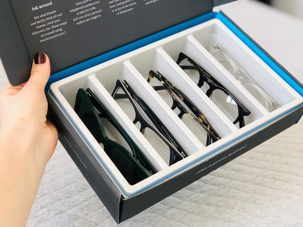 five Warby Parker eyeglasses in try on box
