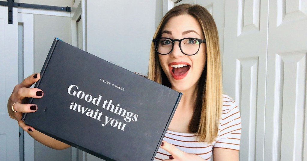 woman holding a box that says good things await you