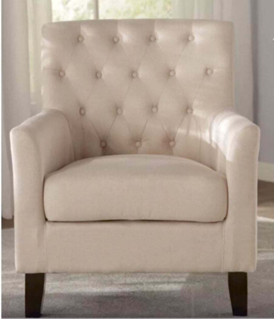 ivory armchair with uphlstered tufted back and wooden legs