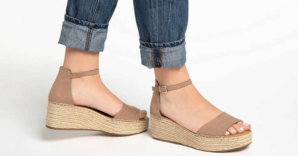 woman wearing wedge sandals