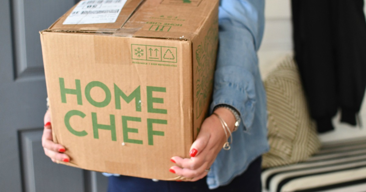 woman carrying home chef box
