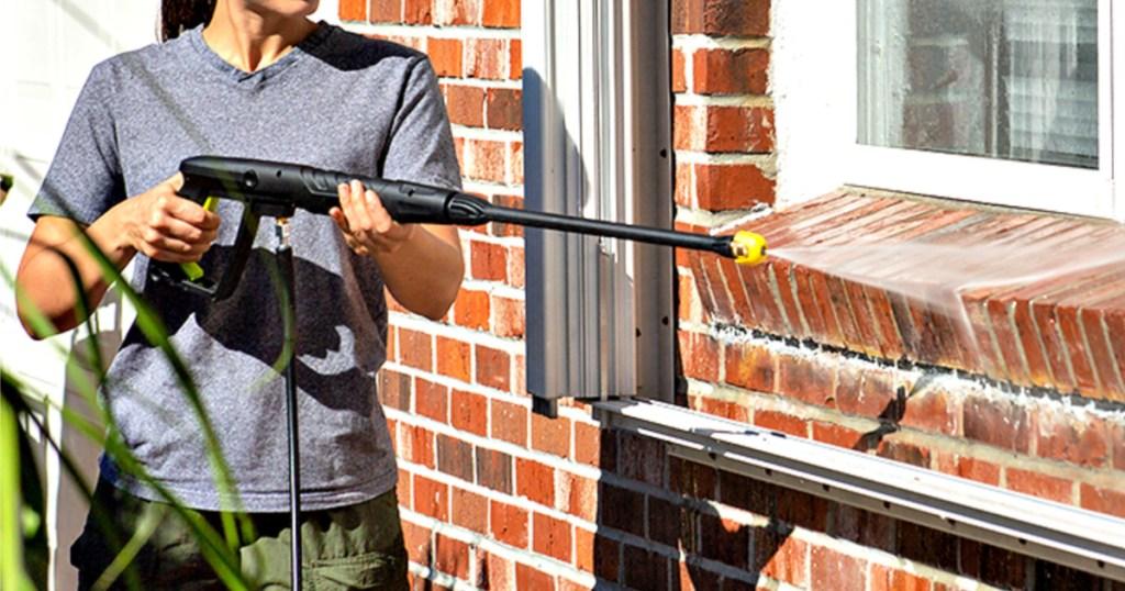 woman using Sun Joe Electric Pressure Washer with Foam Cannon