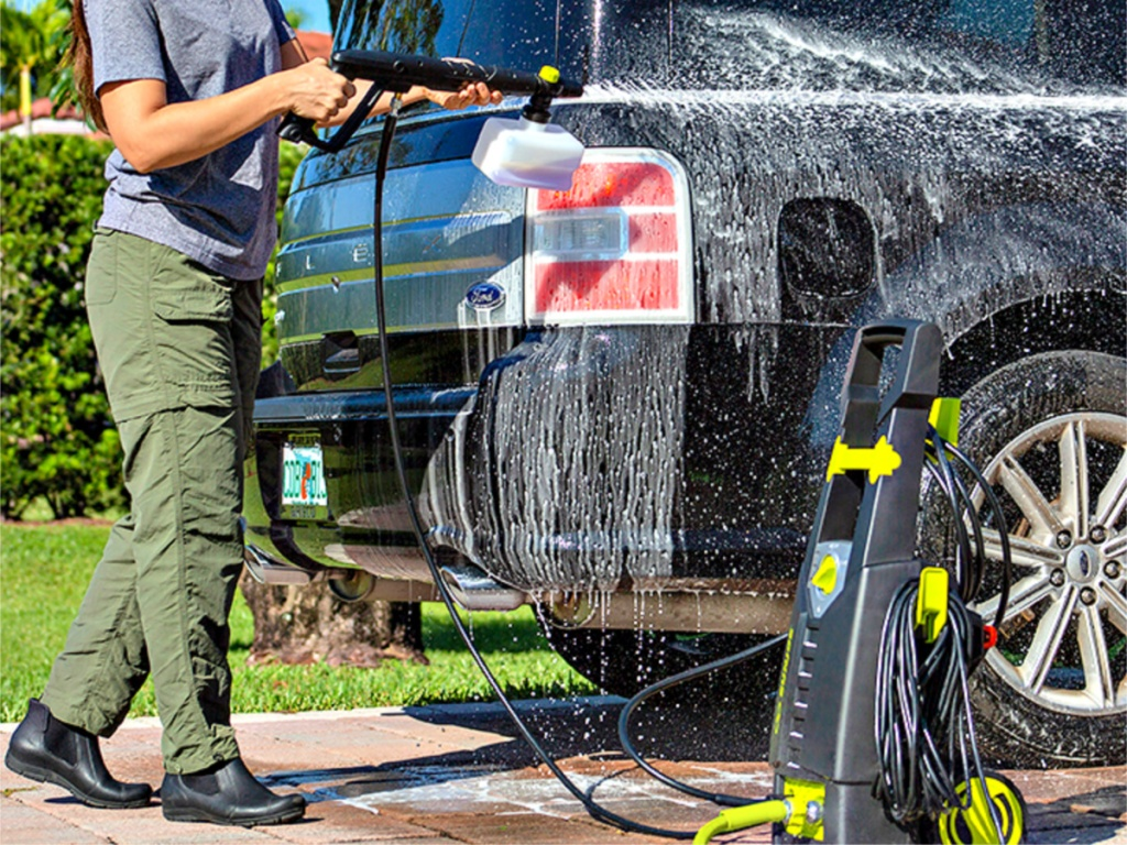 woman washing car with Sun Joe Electric Pressure Washer with Foam Cannon