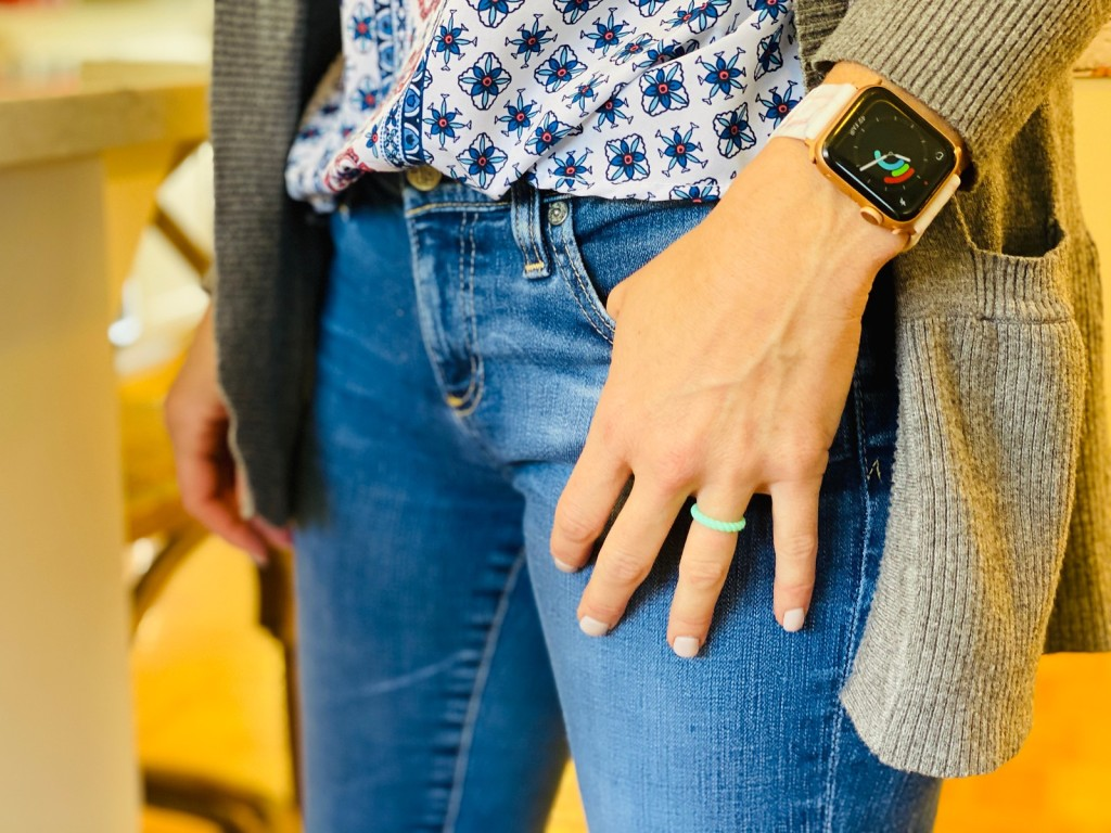 woman wearing silicone ring and apple watch with hand in pocket