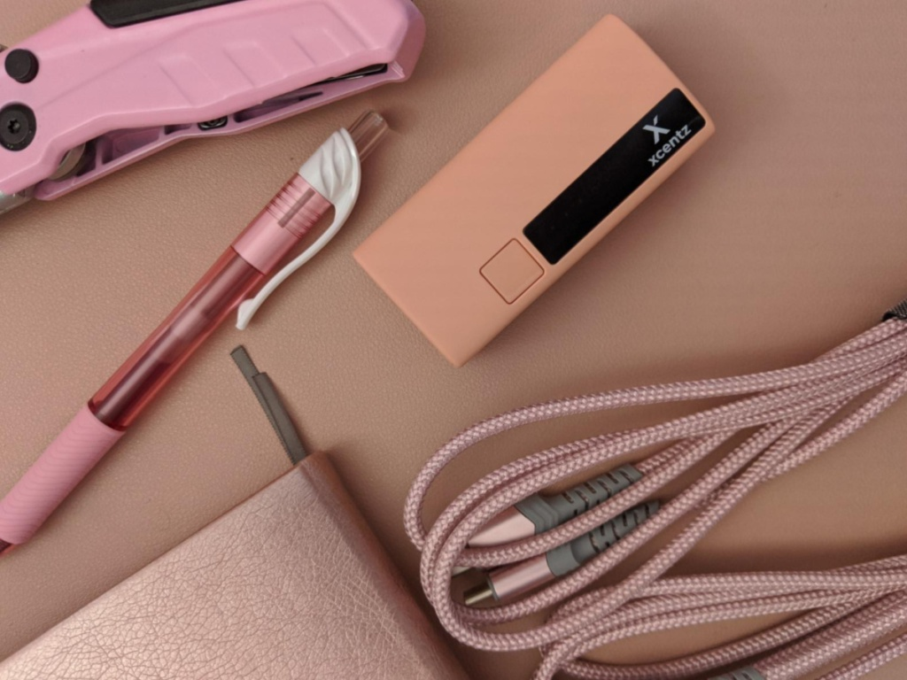 xcentz portable charger with pink items