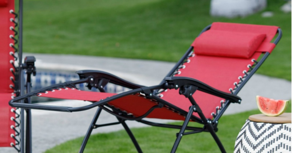 red chair reclined outside by pool