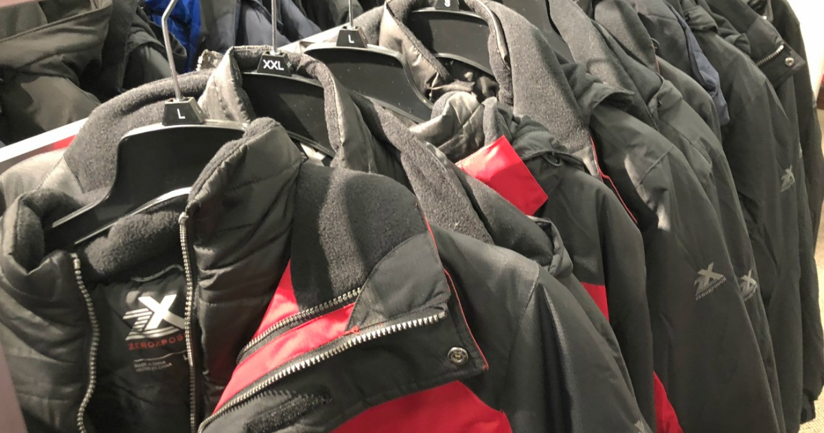row of jackets on hangers at a store