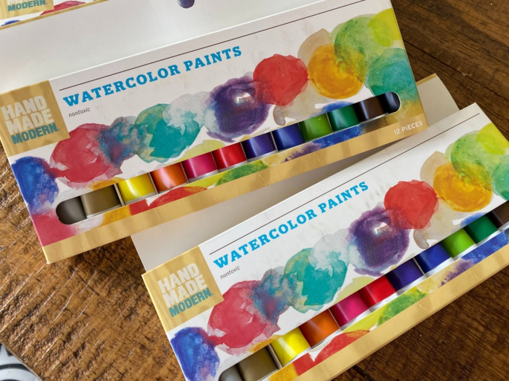 watercolor pain sets on wood table