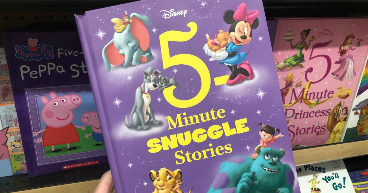 disney themed story book in hand near in-store display