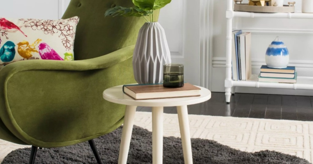 green armchair with white accent table