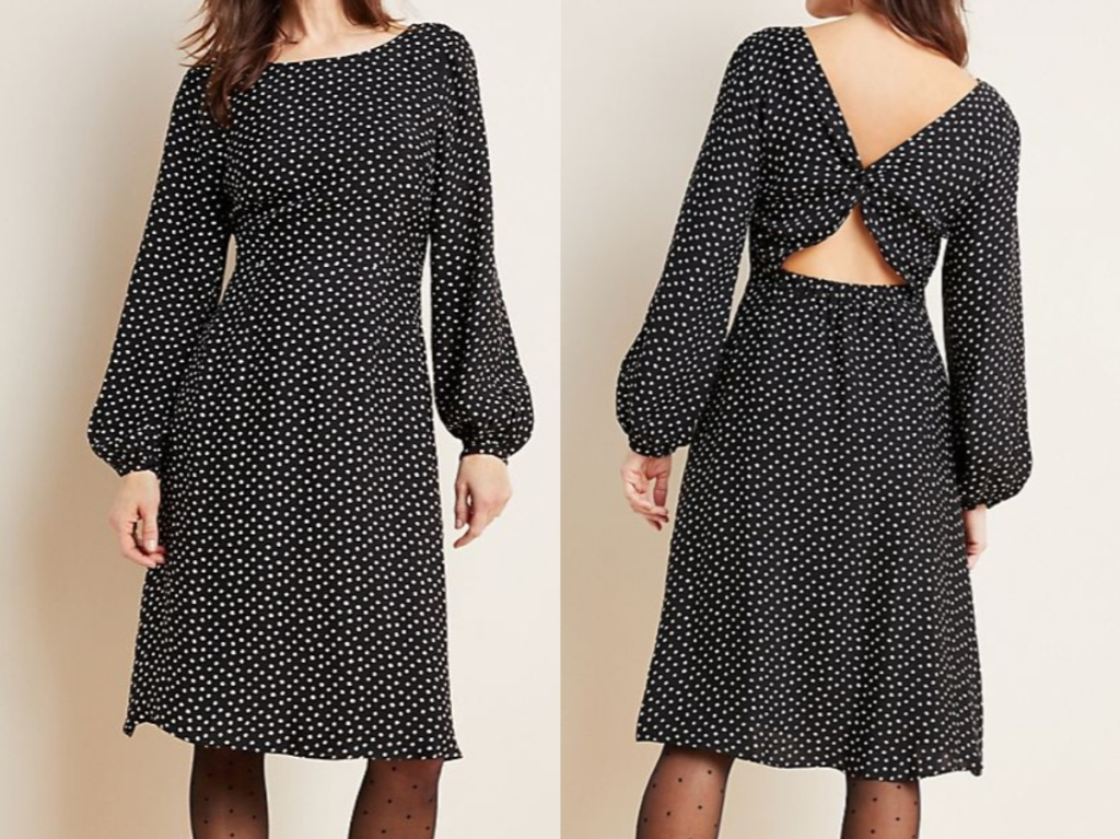 woman in black patterned bell-sleeve midi dress and stockings