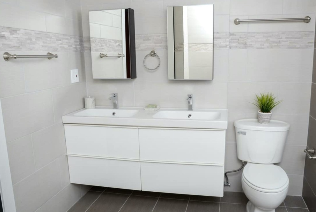 white bathroom with nickel towel bar set
